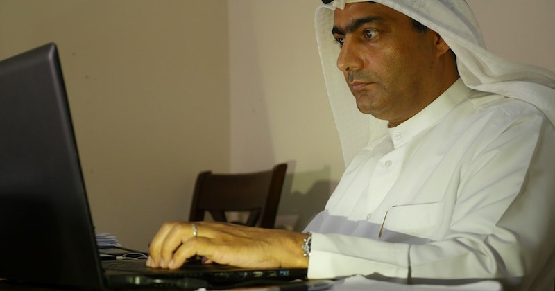 Ahmed Mansoor at computer