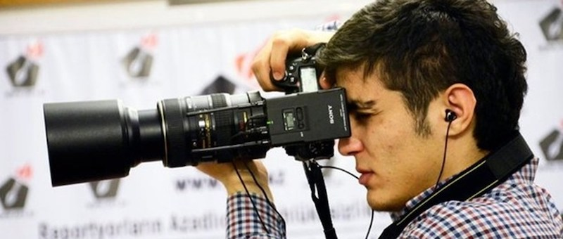 Mehman Huseynov taking a photo