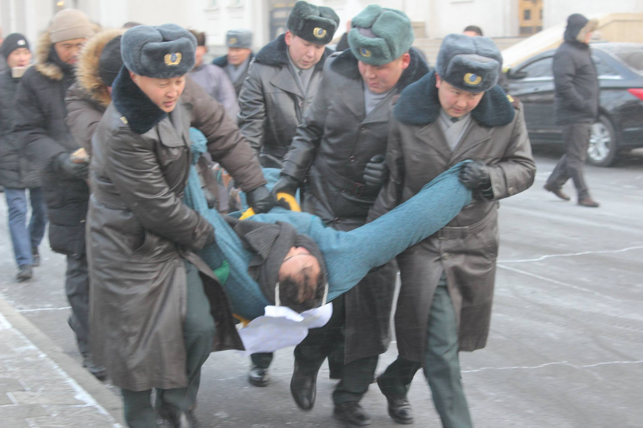 Mongolian police detain protester during a sit-in, March 2016